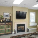 Awesome Sunroom Decoration with Cream Wall Paint Color and Small Fire Place Idea and Rectangular Shaped Carpet Area and Wooden Cabinetry using Drawers and Single Cream Leather Sofa a part of  under Furniture
