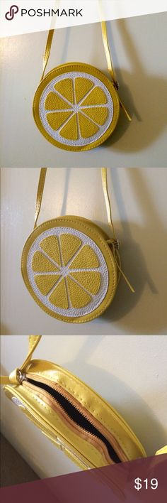 """💥SALE Lemon sweetie 🍋💓 shoulder bag!🆕 Brand new vegan leather shoulder bag! Looks like a large lemon and is perfect for festivals or any event! So cute and never worn but has small defects from sitting in my closet (see pics)- straps are a little crinkled in some areas, back of purse has some indents but front looks perfect! The inside is in perfect condition as well). The straps are adjustable and are about 41-42 """" inches in full length (perfect length, not too long) ✅Brandy Melville…"""