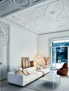 Modern and traditional mix - love the door and ceiling, not the furniture