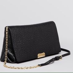NEW Burberry Crossbody and Clutch bag Leather. Adjustable straps. Snap closure. Lined inside w zip closure pocket. 11.5L x 3W x 6H. Strap 23 inches long. Super chic. Retails at $995 plus tax. SORRY NO TRADES. Burberry Bags Clutches & Wristlets