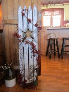 Fence coat rack/ portion of old picket fence remade into this coat rack using IKEA door stops!
