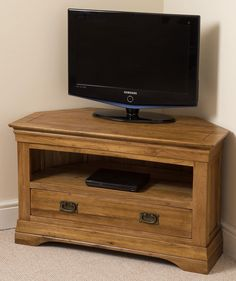 French Chateau Rustic Solid Oak TV Corner Cabinet Classic meets modern with this elegant French Chateau Solid Oak Corner TV Cabinet, thanks partly to the sturdy feel is combined with a glorious natural finish. Media Unit, Tv Unit, Corner Tv Cabinets, Entertainment Wall Units, Living Room Wall Units, Modern Wall Units, Dresser Storage, French Chateau, Solid Oak