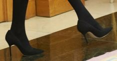 Black suede pointed toe pumps (most likely Nina Ricci)
