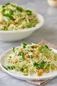 This crunchy cabbage and peanut slaw recipe makes for a great side dish because you only have to combine a few easy ingredients. The combo of cabbage, peanuts, and rice vinegar with oil is one you won't forget. Additional ingredients include fresh cilantro, salt and pepper, granulated sugar and soy sauce.
