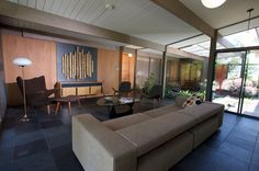 amazing eichler home with bamboo art installation that is mounted on two panels that slide apart to reveal TV Eichler Homes, Room, House, Mid Century Modern House, Interior, Home, Retro Renovation, Retro Interior, Installation Design