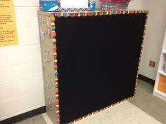 Filing cabinets pushed back to back to make large magnetic board.
