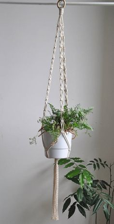 Macrame plant hanger made with cotton rope. Adds boho look to any home decor, perfect for indoor garden. READY TO SHIP in 1-3 business days >> color: natural cotton/ecru/beige/linen >> measurements: (this listing is for the macrame plant hanger only, does not include plant or pot) white pot