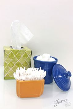 Bathroom organization using Fiesta Dinnerware Sugar Packet Caddy and Jam Jar.