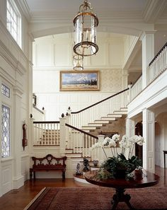 Stairway with stair runner on stained wood stair treads painted newel post other than accent of wood stain. Description from pinterest.com. I searched for this on bing.com/images