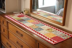 simple table runner with jumbo rick rack on the sides...darling