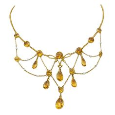 $2,250  1900's Pretty  Citrine Festoon Necklace | From a unique collection of vintage drop necklaces at http://www.1stdibs.com/jewelry/necklaces/drop-necklaces/