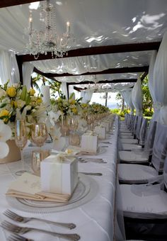 Wedding Tables: I love the the white.. the high floral table arrangements & the Bombonieres on the dinner plates