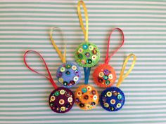"Set of 6 colorful mini Christmas ornaments. Hand embroidered and hand stitched. Measures approximately 1.5"" x 1.5""."