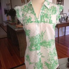 Lilly Pulitzer Vintage Toile & Swiss Dot Blouse Adorable green and white toile patterned blouse in a Swiss dotted fabric with pale pink flowers. Vintage and rare. EUC. 100% polyester. Dry clean recommended, but can machine wash cold, tumble dry low. No trades or Paypal please. Lilly Pulitzer Tops Blouses