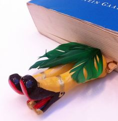"""Crafted from clay, """"Legs in Your Book – Salsa Bookmark"""" is a whimsical and unique bookmark to spice up any type of book."""