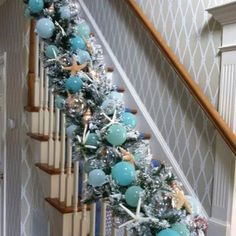 A Coastal Christmas.really full swag for banister in aqua silver white tone. Beach Christmas Trees, Christmas Staircase, Coastal Christmas Decor, Nautical Christmas, Blue Christmas, Christmas Holidays, Christmas Wreaths, Christmas Crafts, Coastal Decor