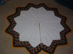 Another Round Ripple Tree Skirt, pattern by Lisa.  Pic from Ravelry Project Gallery for this pattern -- lots of color possibilities shown in the gallery.  . . . .   ღTrish W ~ http://www.pinterest.com/trishw/  . . . .    #crochet