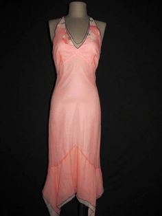 Going on a cruise?  Look at this beautiful peach silk halter dress by BCBG MAX AZRIA!  Simply gorgeous, with an asymmetric hem and halter top - perfect for many occasions!  Available in size 10 and it's currently 20% off!  http://stores.ebay.com/Fashionable-Finds-And-More?_trksid=p4340.l2563
