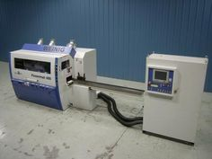 """Used Weinig Model Powermat 400 Moulder - Six Head Moulder w/ CNC Set-up • Working Capacity: 9-1/16"""" W x 4-3/4"""" H • CNC Radial & Axial Positioning of Spindles 2-6 • Electronic Digital Readouts for Heads, Chipbreakers, and Pressure Shoes • Receding Chipbreaker in Front of Both Top Spindles • Smart Brakes for All Heads • Frequency Controlled Feed System with 5-1/2 HP Motor • Infeed Table: 98"""" x 9-1/4"""" • Safety/Sound Enclosure and Hood • HSK Set-Up Stand • Year: 2007!"""