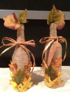 Twine wrapped wine bottles....use as a vase or simply as a decoration