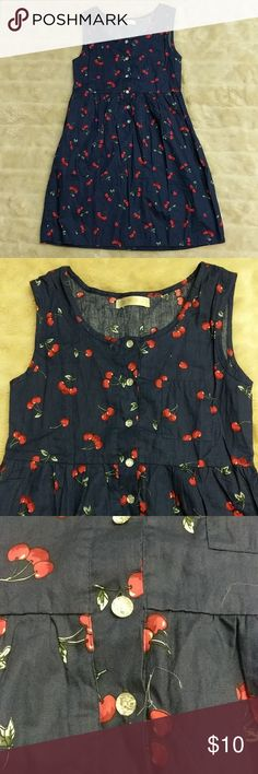 Navy Cherry Dress Rockabilly style navy blue dress with all over cherry print. Small left breast pocket. Crystal-like buttons. NWOT. There's no sizing on this dress. But after being disappointed with the size myself, I think this would best fit on a size medium if you have a small bust and wear with a belt. Could possibly fit a large too if you have zero boobs. I'm a large and I could put it on but could not button it around my boobs. Dresses