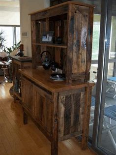 Old pallets turned into antique Kitchen Dish Cabinet