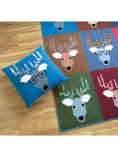 "Dwight the Deer includes instructions for making two quilt sizes and a 24"" x 24"" quilted pillow cover. These friendly deer blocks are made using conventional patchwork techniques. The pattern also includes a complete list of the cut pieces ..."