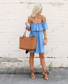 Casual off the shoulder blue dress with tan handbag and shoes.