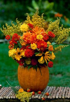 DIY pumpkin vase. 1. Hollow out a pumpkin 2. Place a vase, soup can, or other container in the pumpkin filled half way with water 3. Arrange a pretty fall bouquet