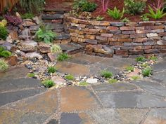 Ledgestone retaining wall, rock water feature, and flagstone patio and steps - by  Shambhala Landscape & General Construction