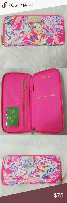 """Lilly Pulitzer Travel Wallet in Dragonfruit Authentic. Travel Wallet in Printed Polyester. Zip around closure. Interior features 2 Slip Pockets, 7 Credit card slots, 1 clear ID slot, pen sleeve and a zip pocket for change. Gold metallic logo patch on exterior. Solid polyester lining. 8 3/4""""W x 4 1/2""""H x 1""""D. Brand new with tag! Price is firm. Lilly Pulitzer Bags Wallets"""