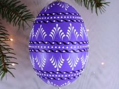 This is a small goose egg pysanka. It is painted purple and decorated with white and dark purple wax. To create this egg, I use the pinhead method also Intermediate Colors, Polish Easter, Hand Painted Dishes, Easter Egg Pattern, Egg Tree, Easter Egg Designs, Ukrainian Easter Eggs, Egg Decorating, Christmas Bulbs