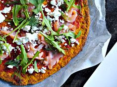 Recipe for a healthy grain free pizza crust made with mashed pumpkin that is paleo and can be made vegan.