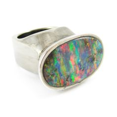 K. BRUNINI opal ring - The Skipping Stones Collection - Imagine a crisp New England autumn, on the shores of Wenham Lake. A small child breaks the calm water into a chain of perfect rings, as her grandfather passes on a time-honored secret to skipping stones.