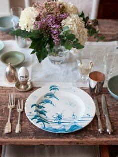 Old silver, blue and white china, lilacs and hydrangeas, rustic table, white linen