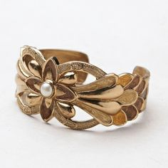 Jasmine Cuff.  Art deco meets Arabian Nights. Bronze and hand-painted enamel with a freshwater pearl accent.