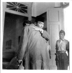 President Soekarno welcoming hug after General Soedirman back from guerrilla battle against Dutch