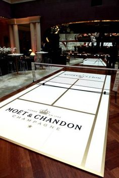 Moet & Chandon tiny tennis court in Paris bar. Now that's a fun place to party!