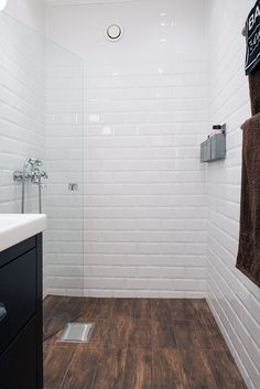 Using tile that looks like wood makes a seamless flow into shower floor.