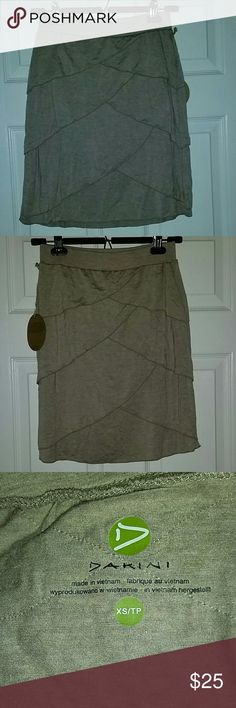 "Dakini oatmeal colored  tiered skirt Sz. XS NWT Dakini oatmeal colored  tiered skirt Sz. XS NWT. Super soft jersey feel material. 19"" long. 96% modal 4% spandex dakini Skirts"