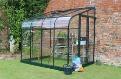 one end of the studio would have a lean to greenhouse for m's tomato plants.