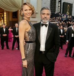 Stacy Keibler and George Clooney arrive at the Oscars on Feb. 24, 2013.
