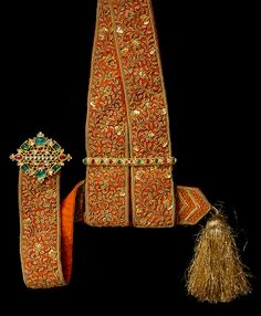 Silk sword sash with jewelled gold fittings, about 1900, India The Al Thani Collection, © Servette Overseas Limited 2014.