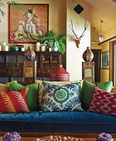 Bohemian...Love funky pillows and a bold couch.
