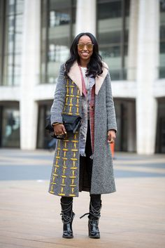 Shiona Turini layers up her coats to beautiful effect. Fendi coat, Chanel boots. #StreetStyle