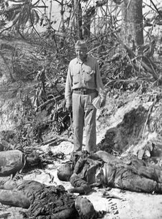Captain Ellis M. Zacharias viewing dead Japanese soldiers. MaritimeQuest - Seaman 1st Class Elmer Alfred Bishop, USNR Collection Page 4