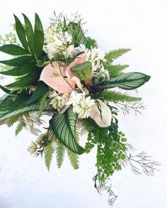Tropical bridal bouquet with jasmine, calathea, anthurium, lotus, hellebore, tuberose, phalaenopsis, and ferns. Honey and Poppies. www.honeyandpoppies.com