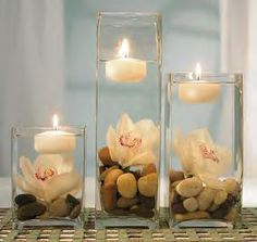 floating candles and stones in glass