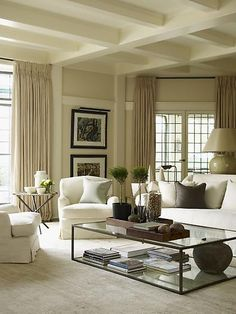 Serene Living Room: A wonderful simple design with straight lined furniture pieces adds soft elegance to the room by having a soft curve to the upholstered pieces.  Beautifully framed windows, and millwork.