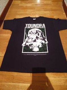 toundra — Belenos green (black shirt, green and white print)